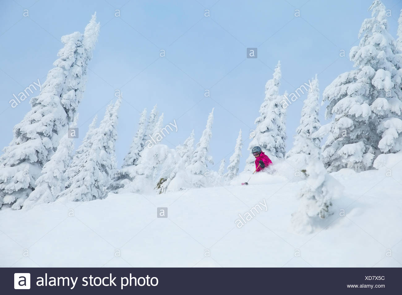 Low angle view of mature woman on ski slope - Stock Image