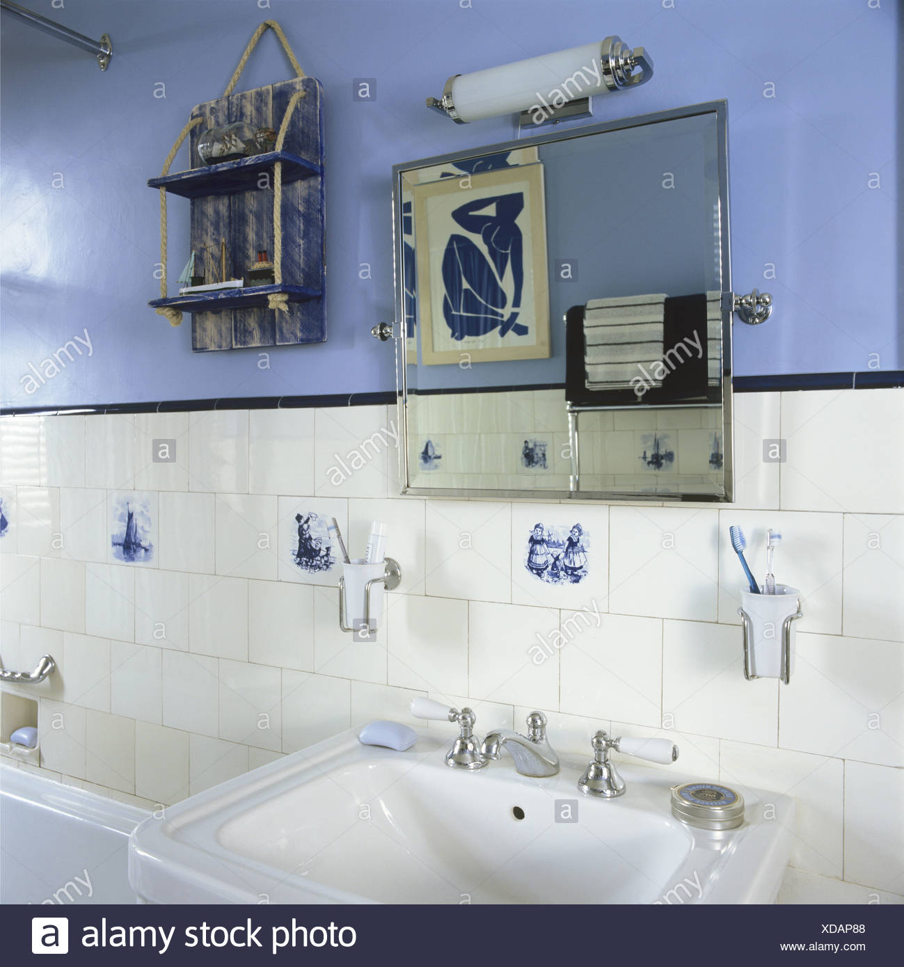 Close Up Of Light Fitting And Simple Mirror Tiled Splash Back And Basin In  Pale Blue Cottage Bathroom