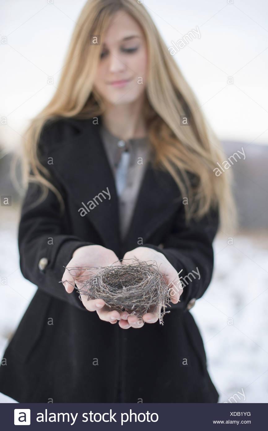 Woman Holding Bird's Nest - Stock Image