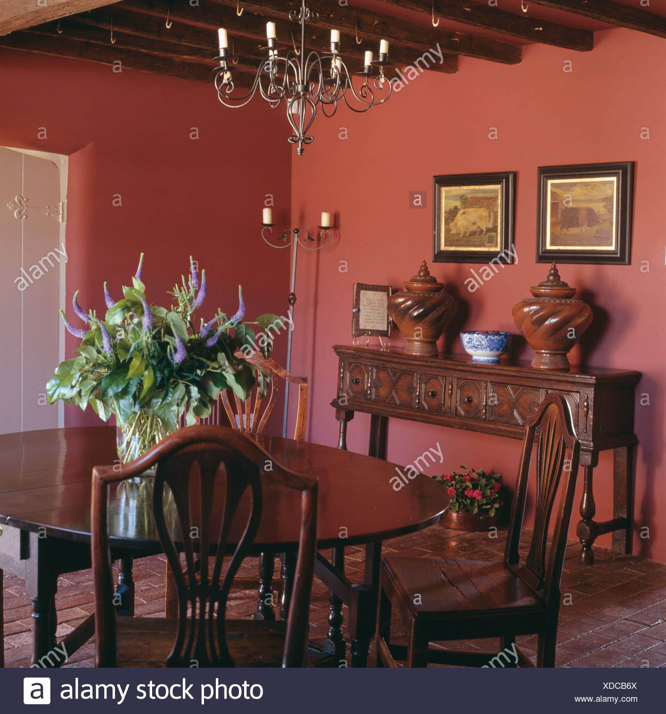 Metal chandelier above antique oak table and chairs in deep pink country  dining room painted with Farrow+Ball paint - Metal Chandelier Above Antique Oak Table And Chairs In Deep Pink