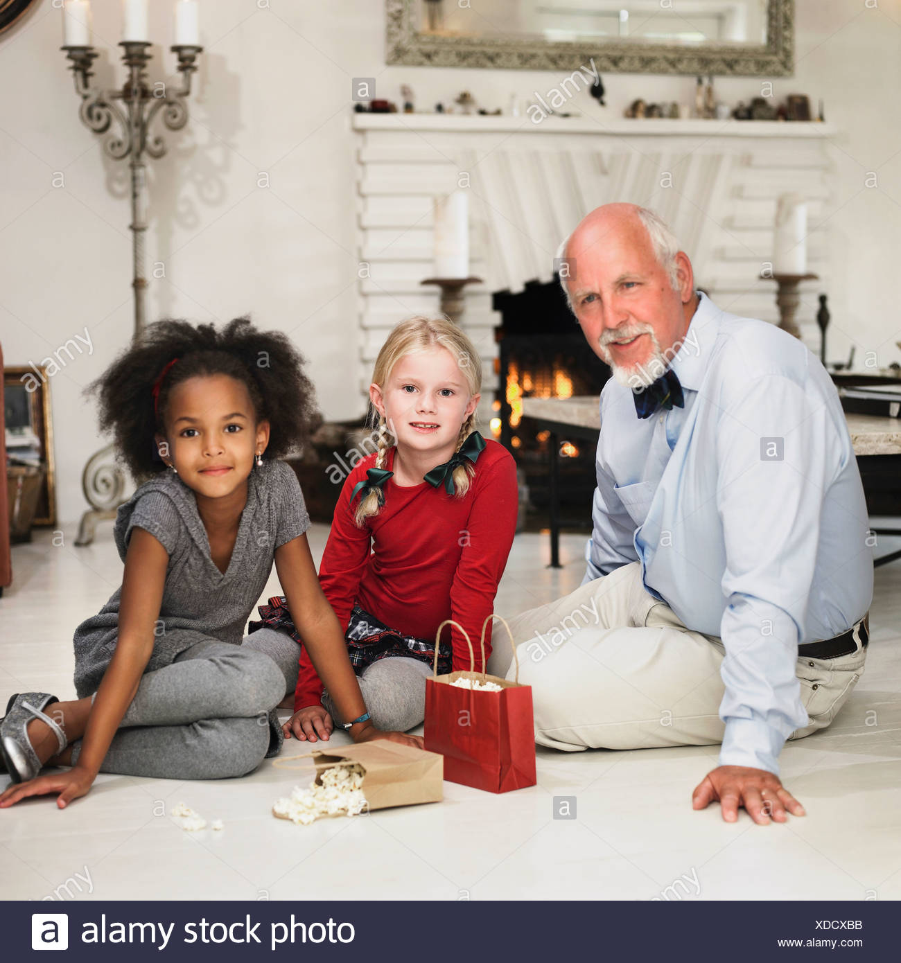 Older Man And Girls With Christmas Gifts Stock Photo 283640543 Alamy