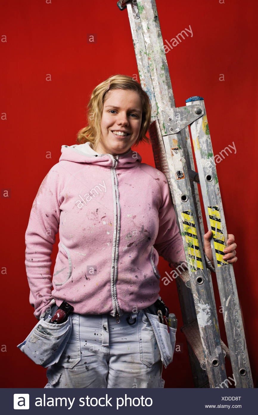 Studio portrait of female construction painter - Stock Image