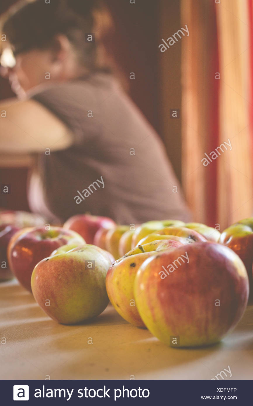 Close-Up Of Apples On Table At Home - Stock Image