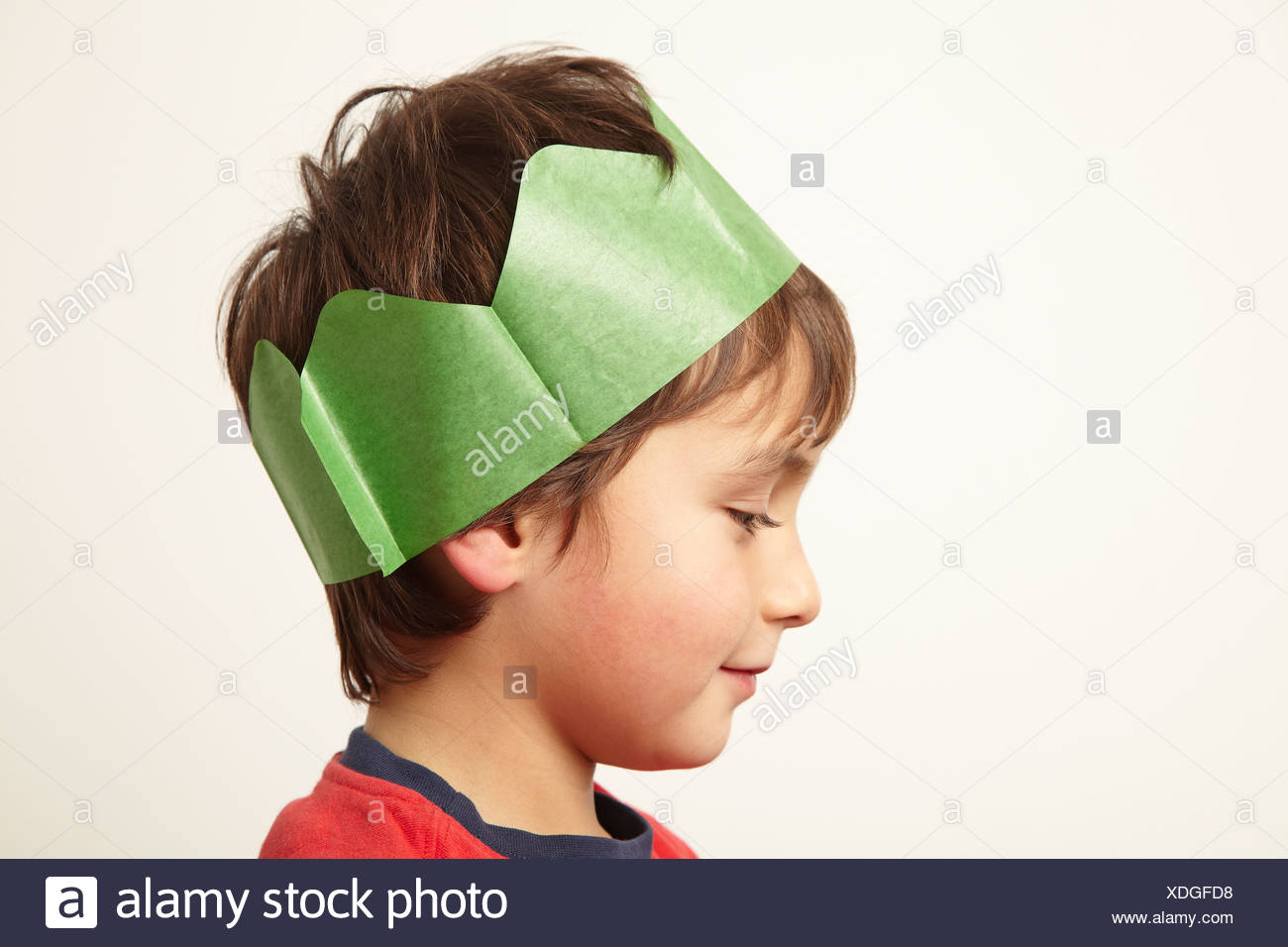 3027acc3a947f Boy wearing paper crown hat at Christmas Stock Photo  283719780 - Alamy