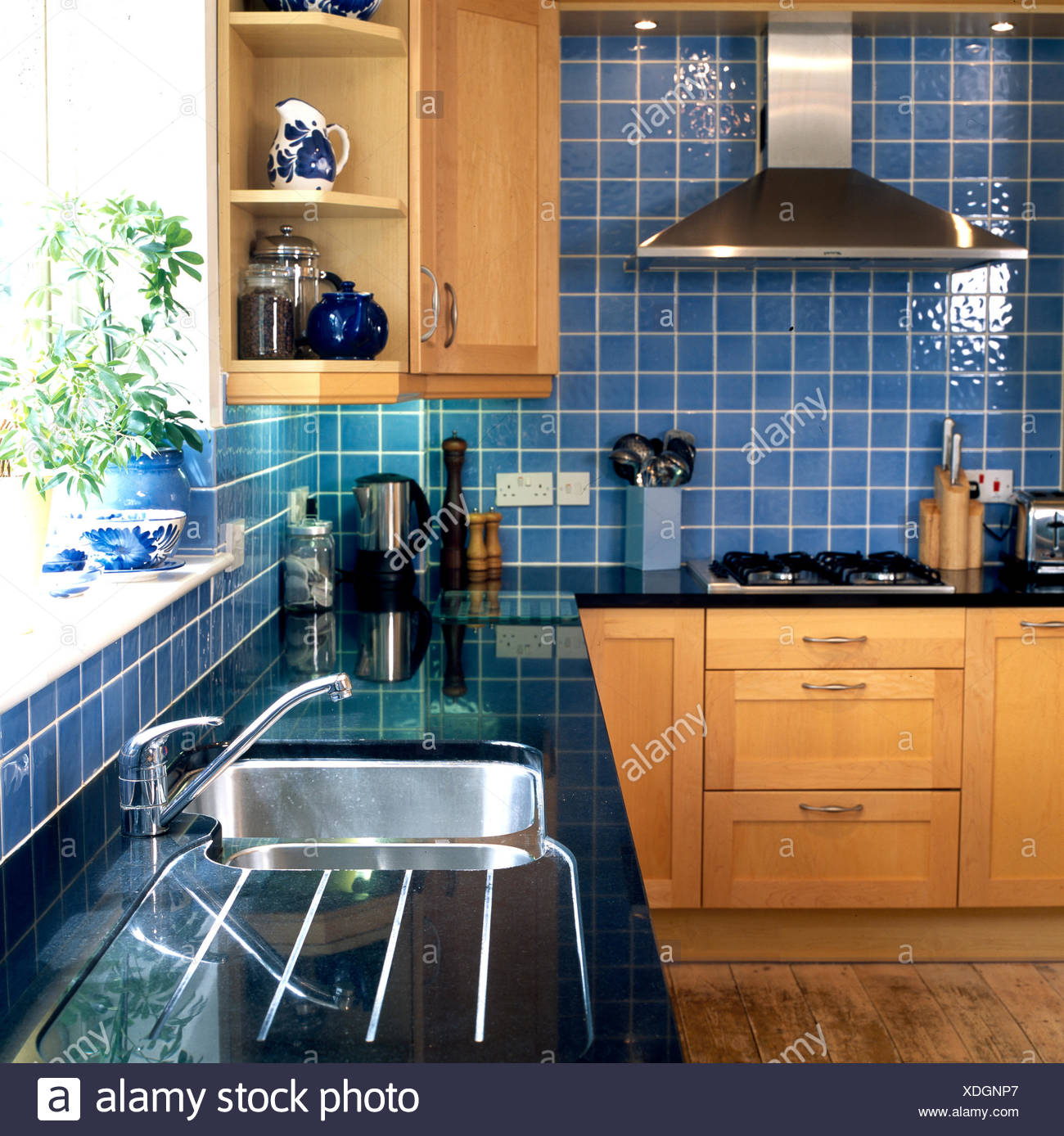 Blue tiled kitchen with black counter top Stock Photo: 283724735 - Alamy