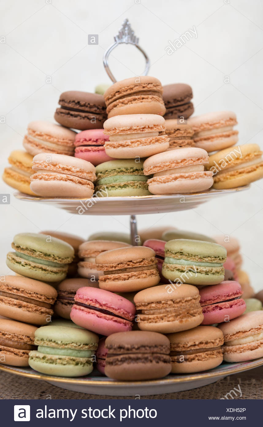 Macaroons on a cake stand - Stock Image