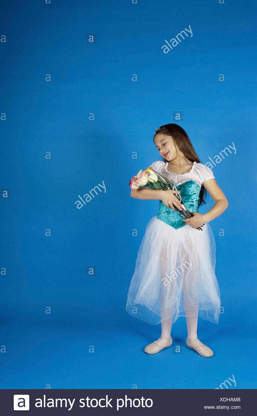 Girl In A Ballerina Outfit Holding A Bouquet Of Flowers Stock Photo