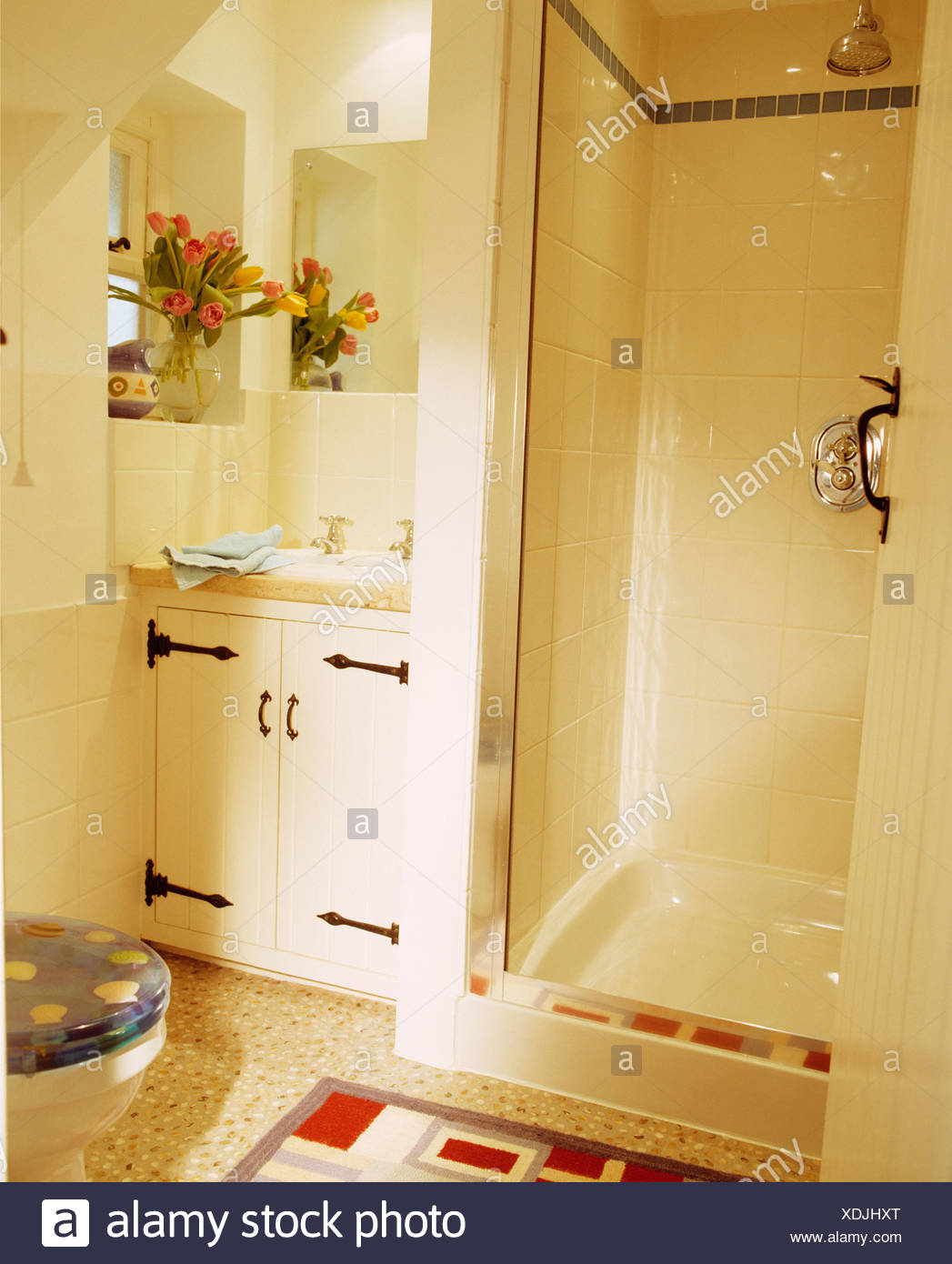 White tiled shower cabinet in small coastal bathroom Stock Photo ...