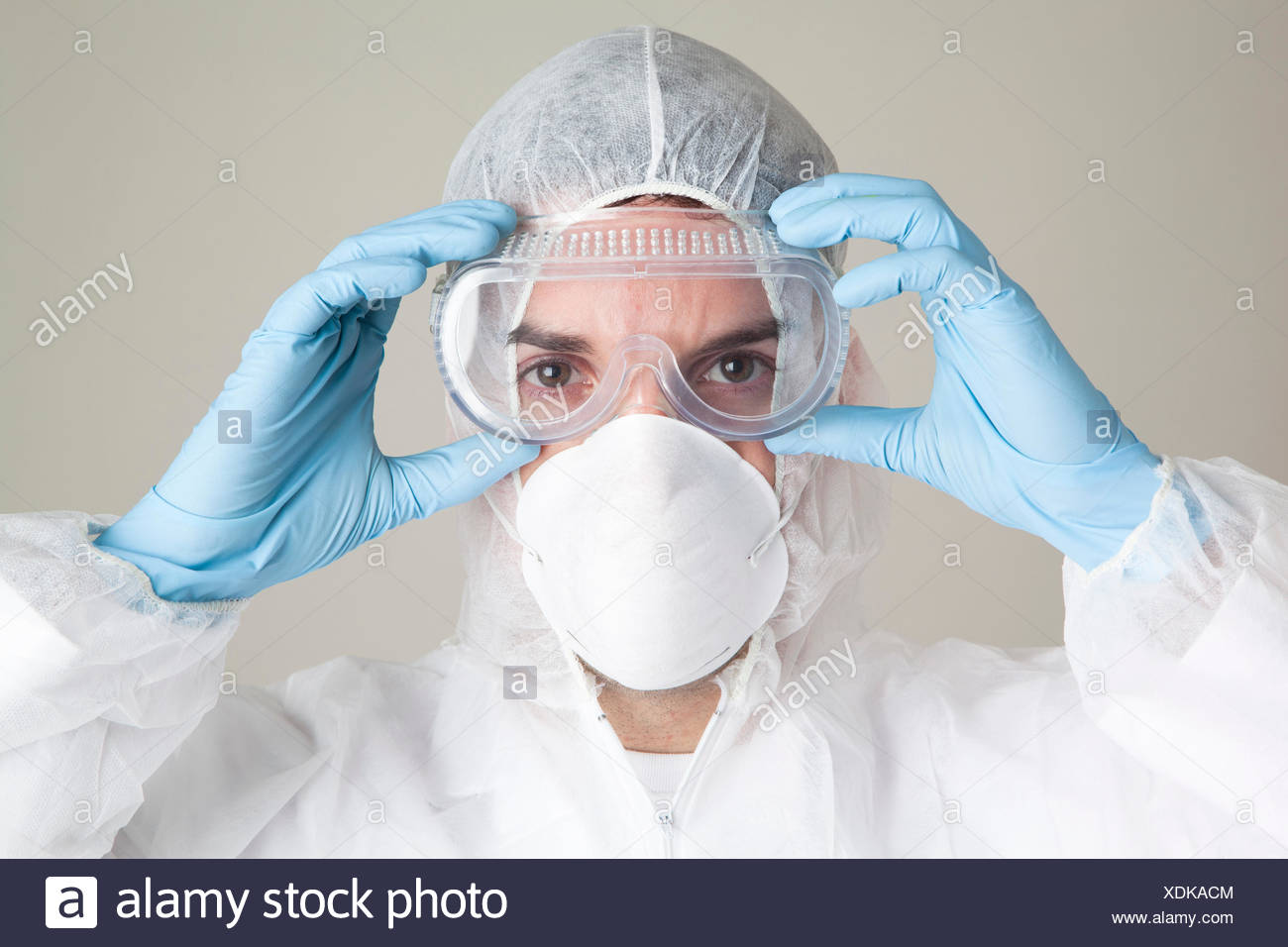 Scientist wearing protective suit - Stock Image