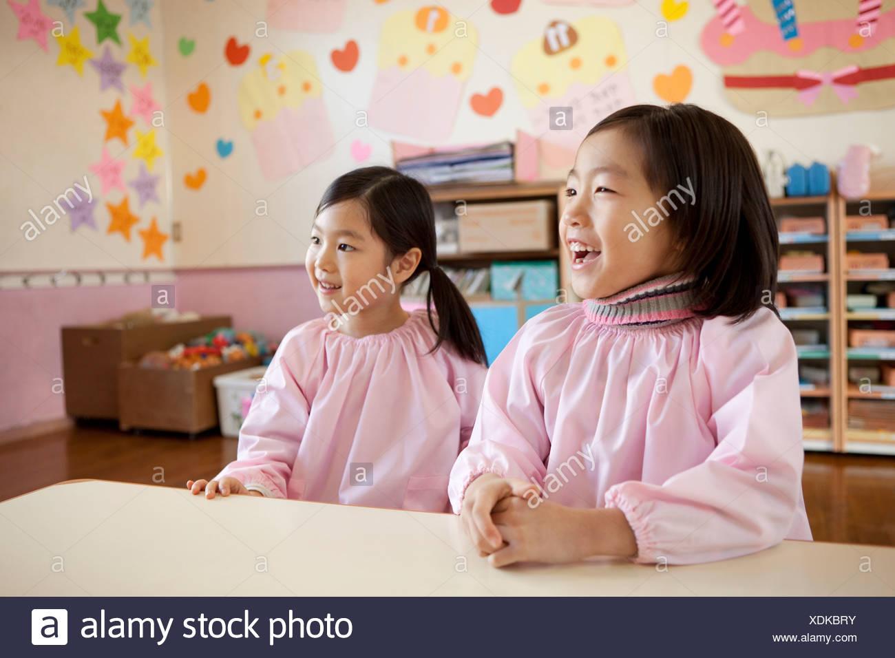 Kindergarten Children Sitting - Stock Image