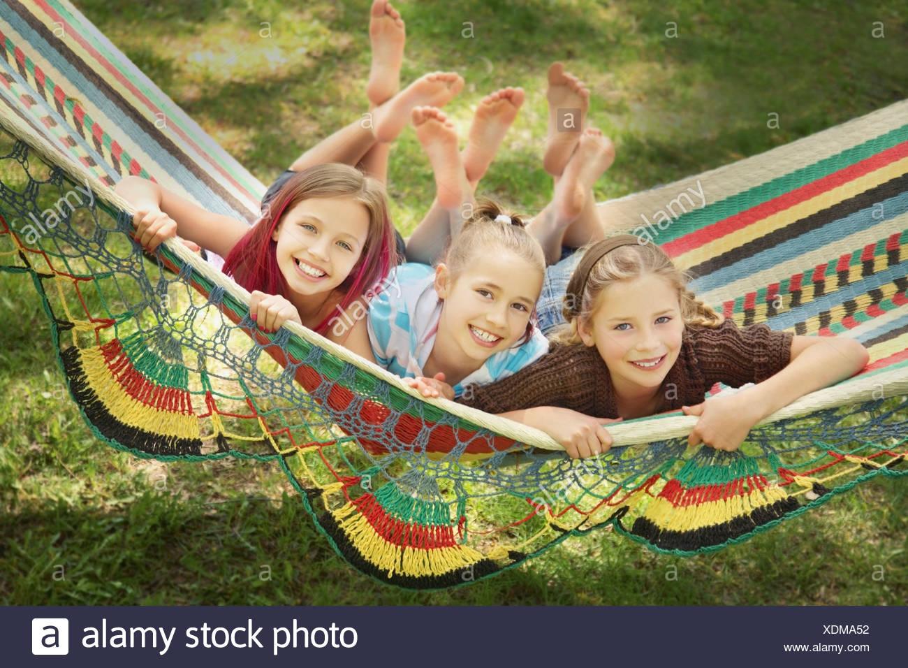 Edmonton, Alberta, Canada; Three Girls Laying In A Hammock - Stock Image
