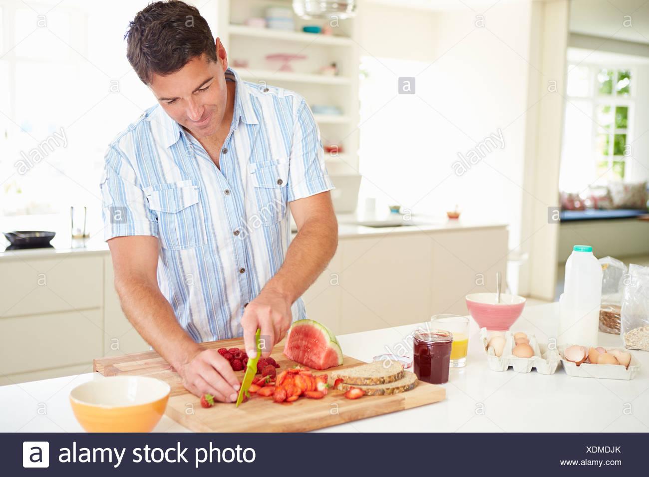 Man Preparing Healthy Breakfast In Kitchen - Stock Image
