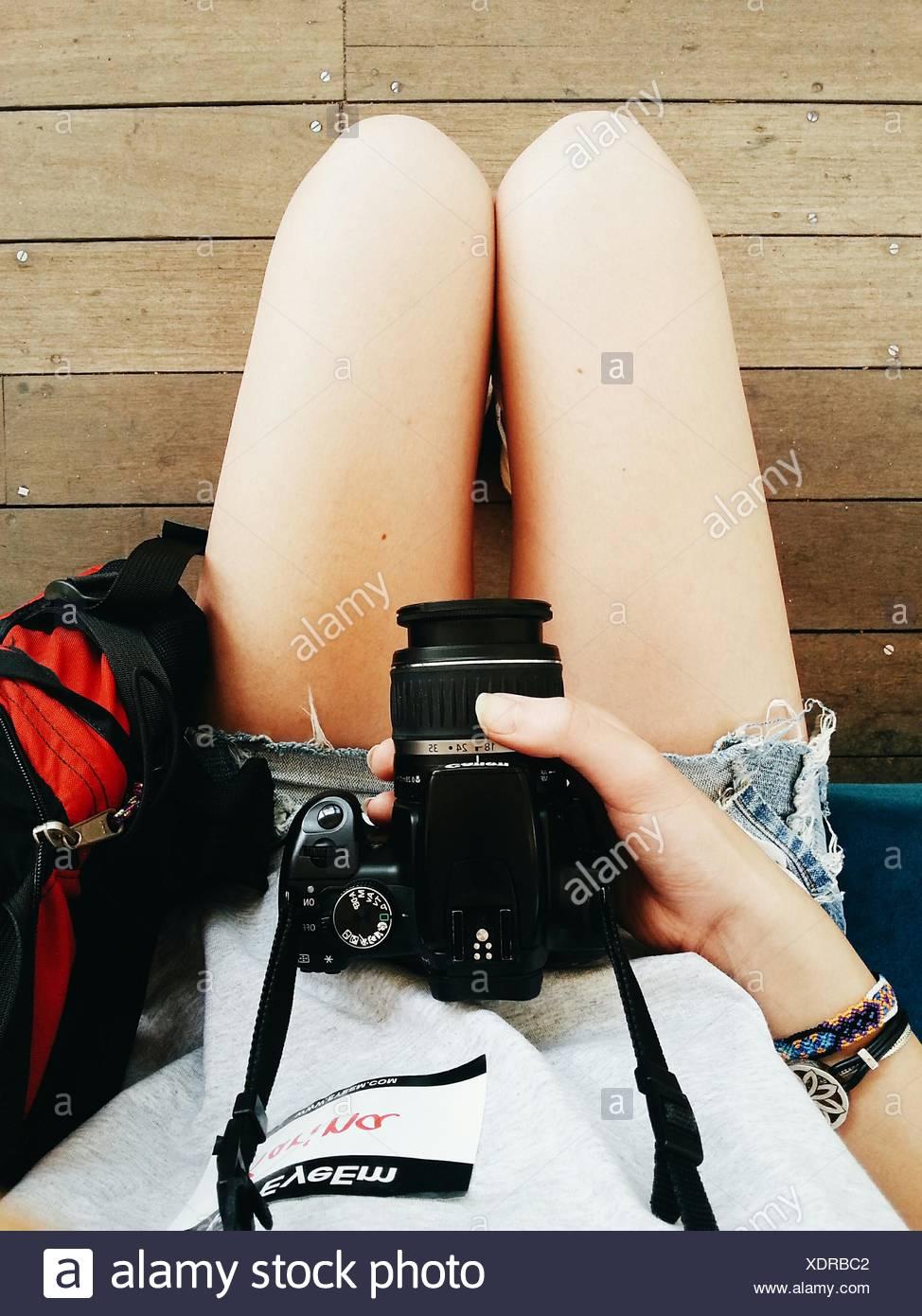 Woman Holding Camera - Stock Image