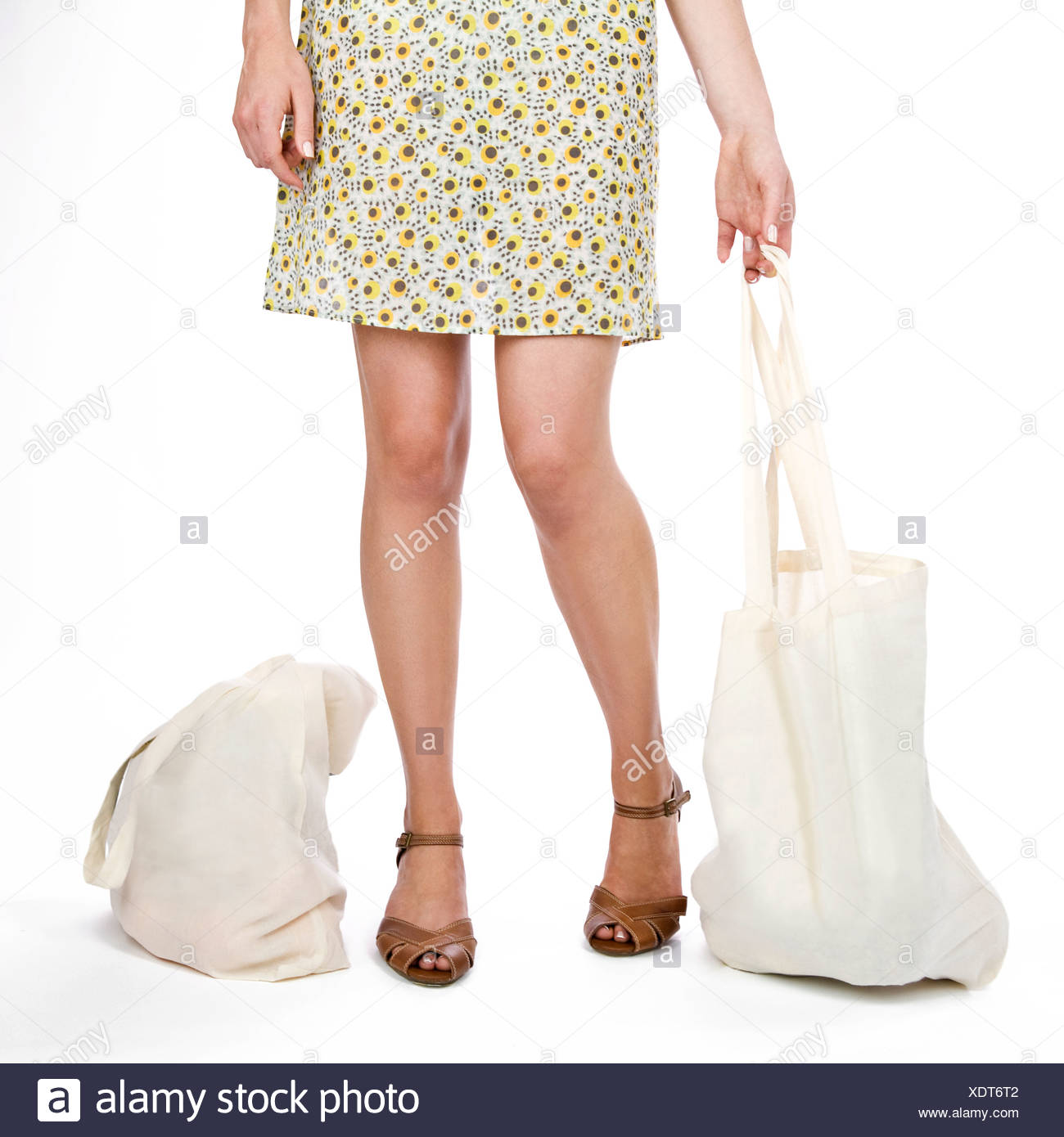 A Young Woman With Shopping Bags - Stock Image
