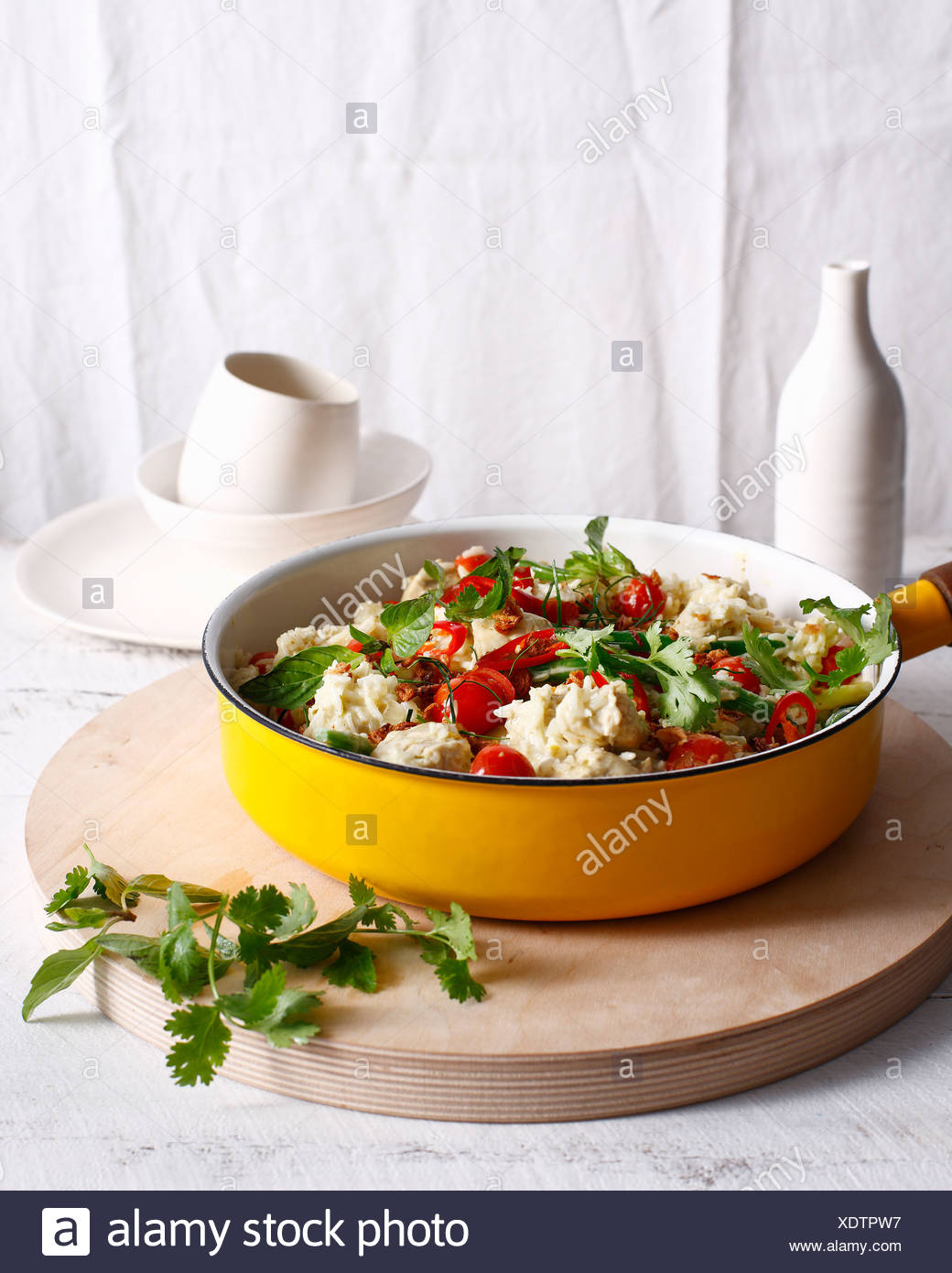 Pan of Thai chicken and herbs - Stock Image