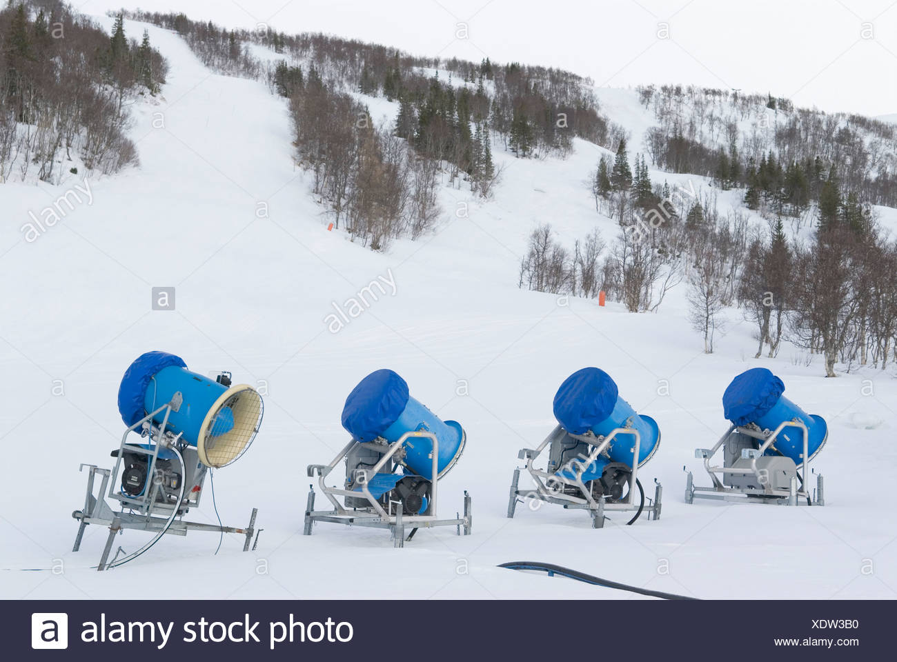 snow cannons in a row on winter landscape at storlien, sweden stock