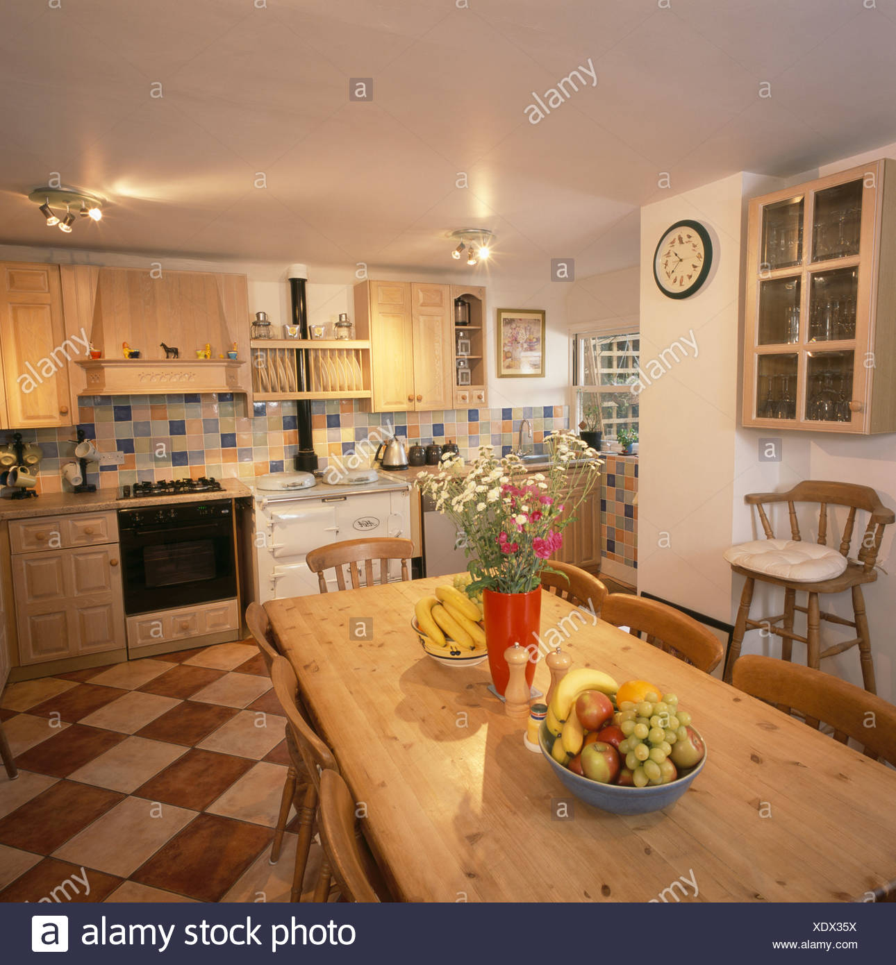 Ceiling lights and old pine table and chairs in country kitchen with ceiling lights and old pine table and chairs in country kitchen with creambrown checker board flooring aloadofball Gallery