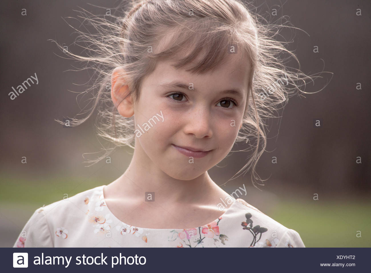 Portrait of pretty girl smiling and looking away - Stock Image