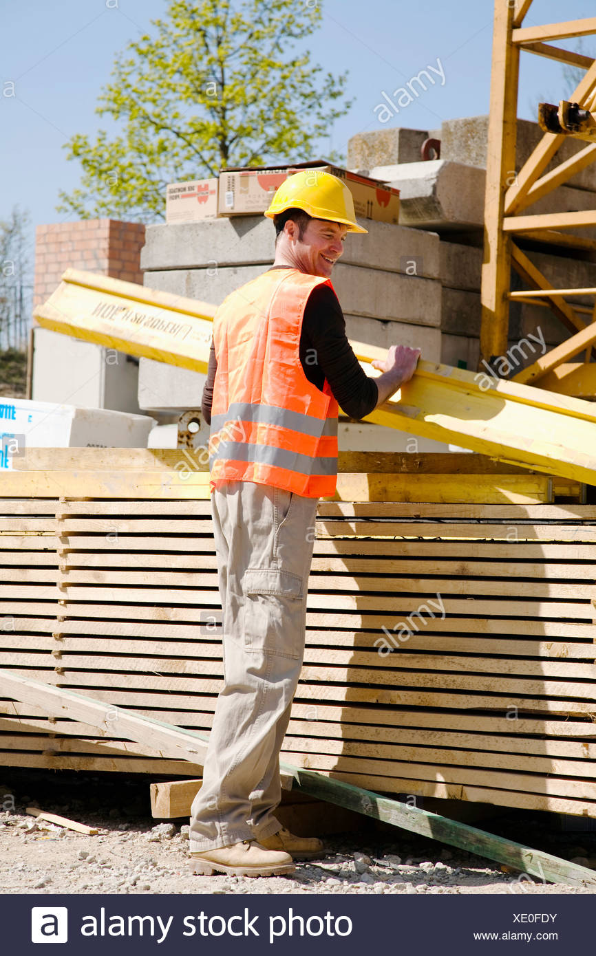 construction worker with wooden plank - Stock Image