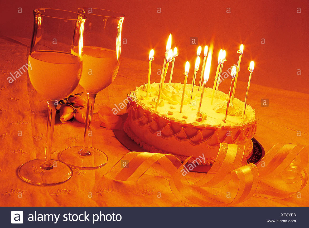 Birthday Cake And Wine Glasses On The Table Stock Photo 284058496