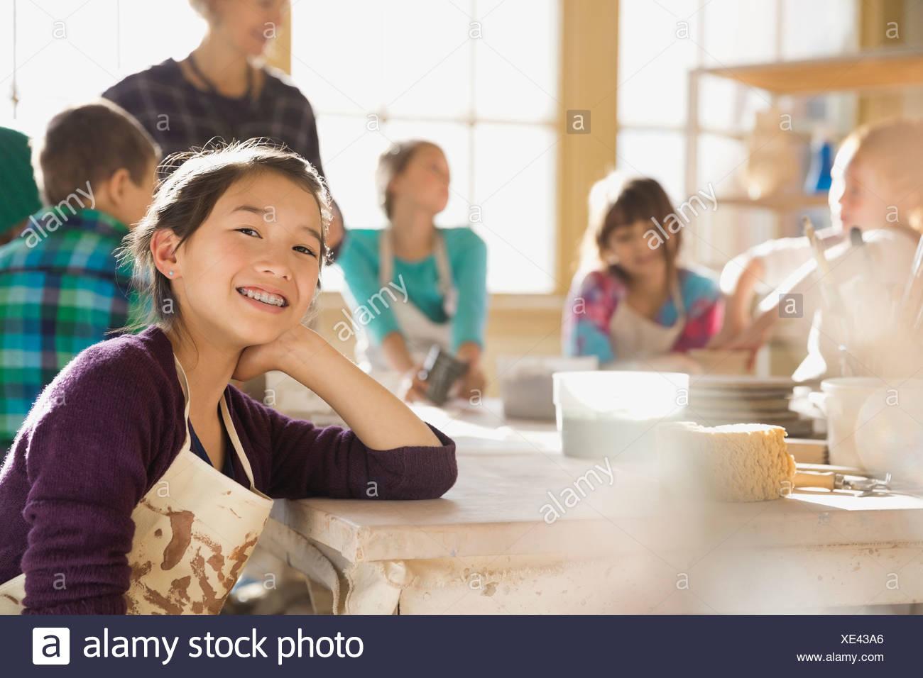 Portrait of girl in art class - Stock Image