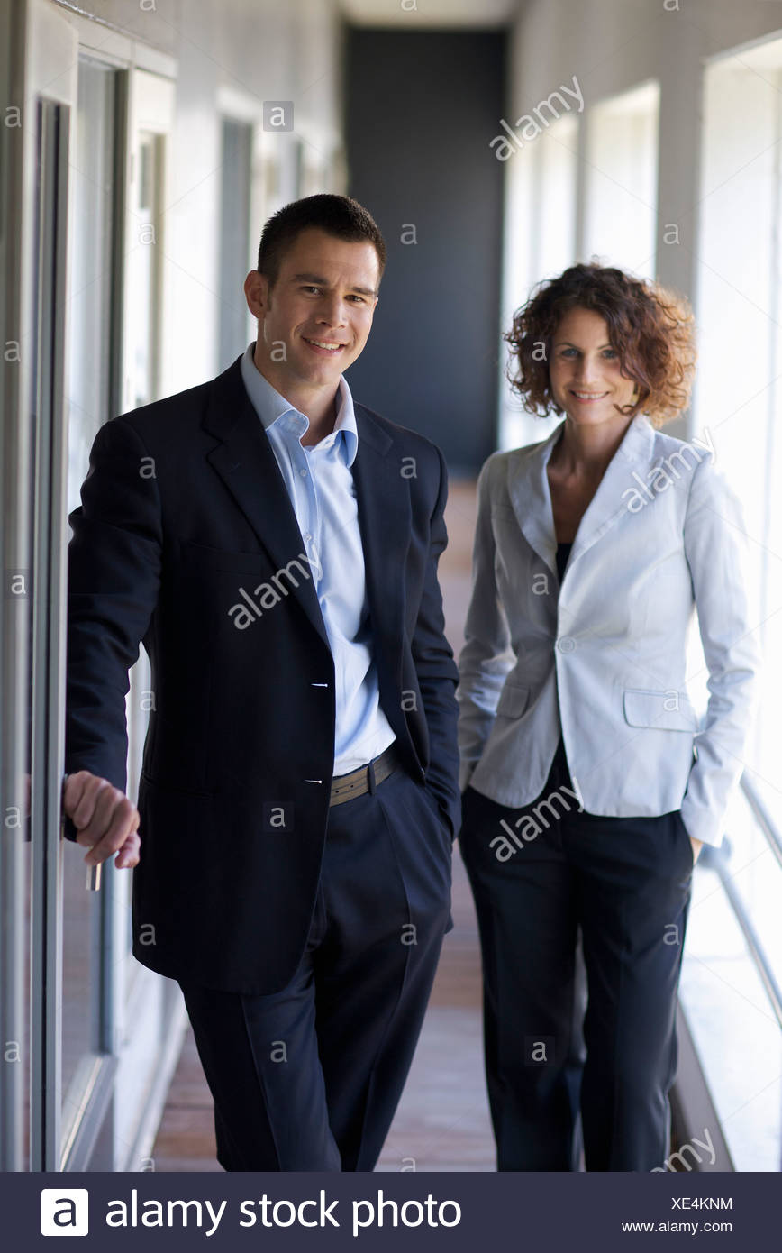 Business partners smiling at camera - Stock Image