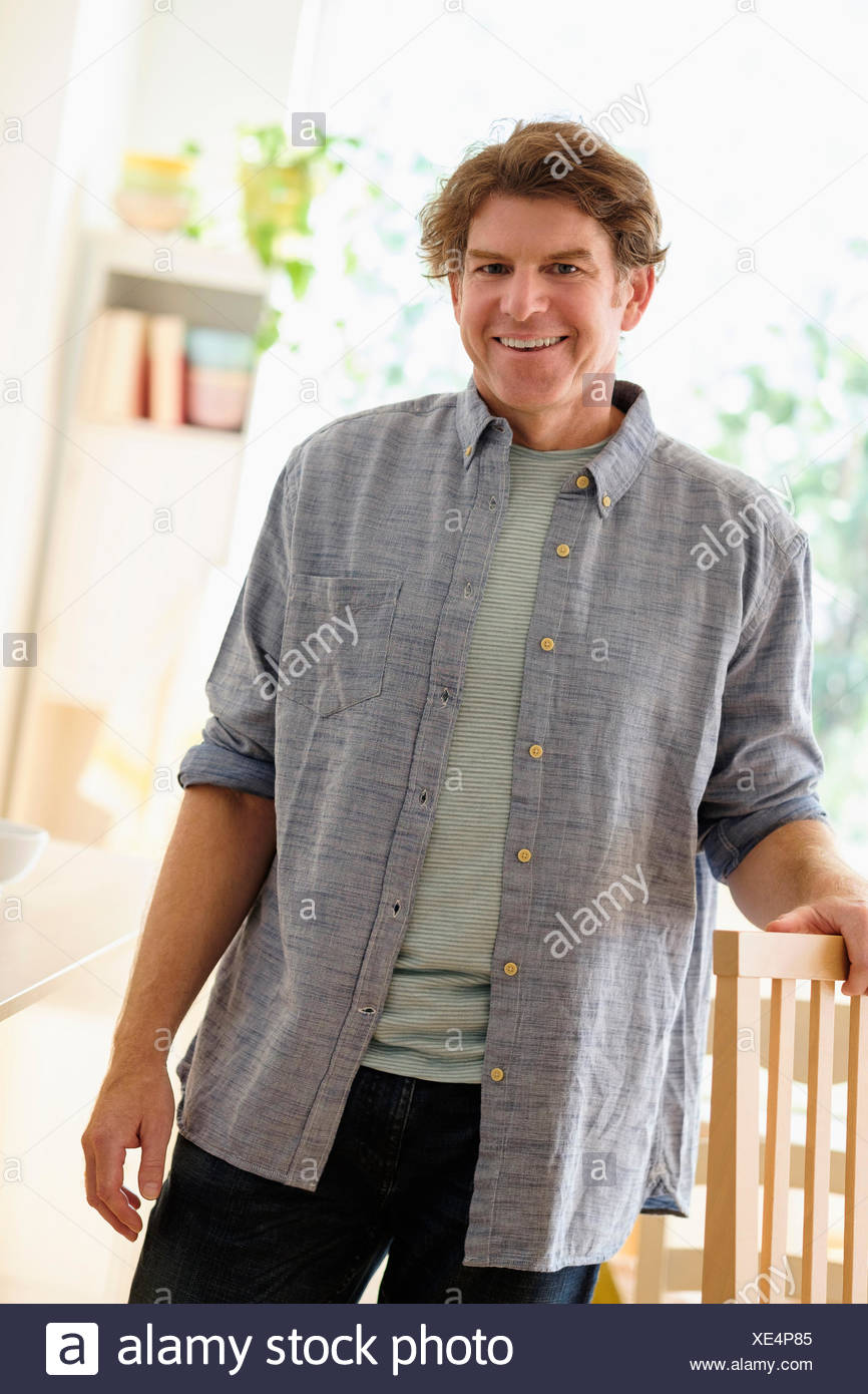 Portrait of mature man indoors - Stock Image