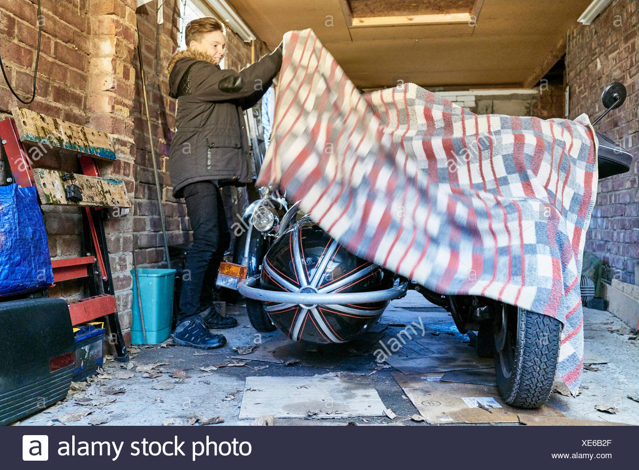 Boy Removing Blanket From Motorcycle And Sidecar In Garage Stock Disassembly Photos Images Alamy Cultura Creative Rf Photo