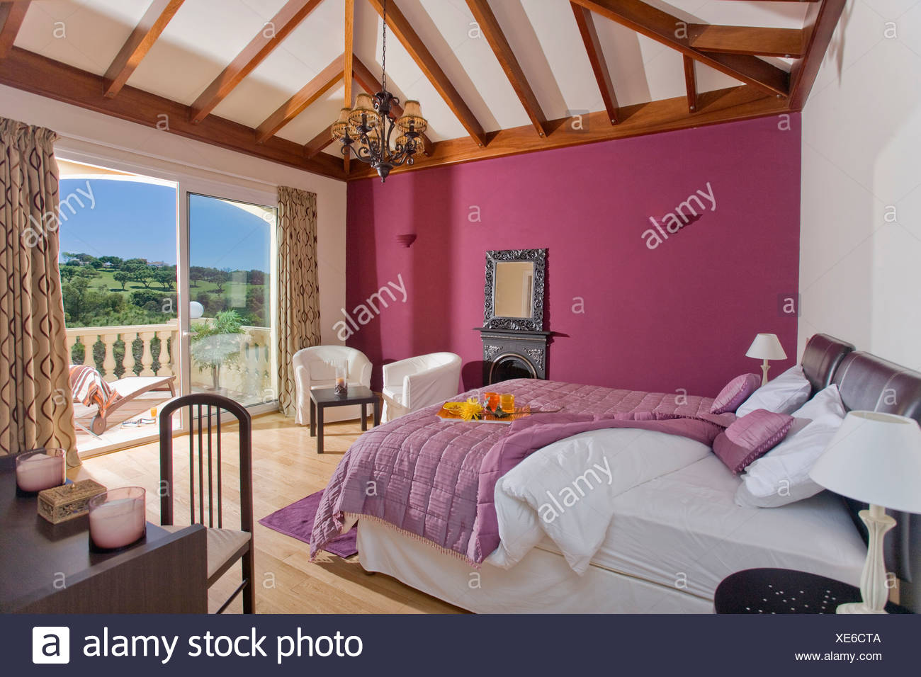 Purple Quilt And White Bedlinen On Bed In Pink Bedroom With Beamed