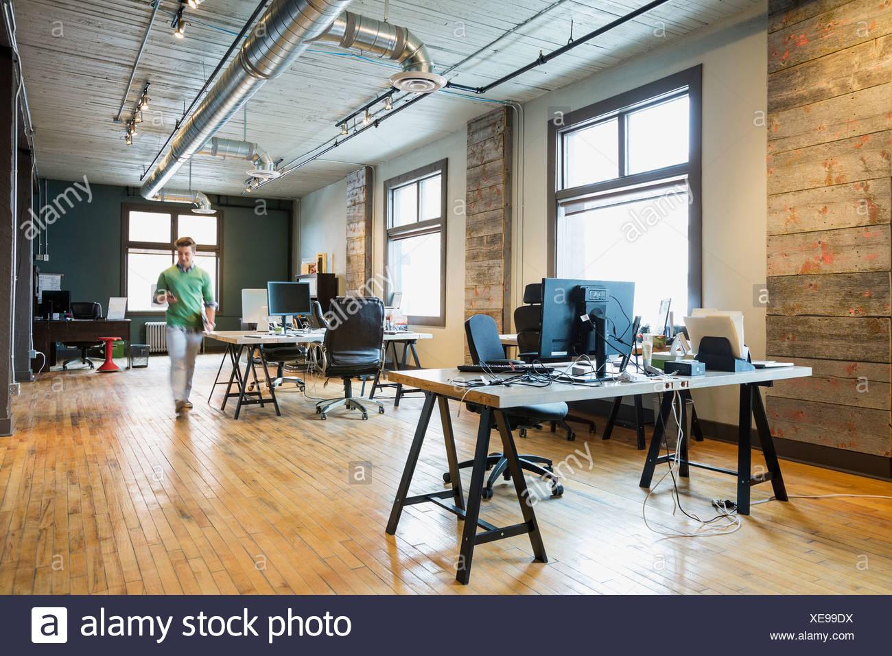 Charming Entrepreneur Walking In Creative Office Space