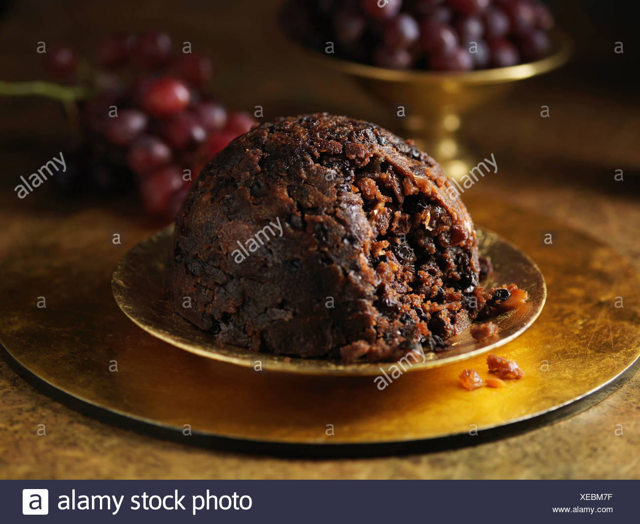 Christmas pudding with fresh grapes - Stock Image