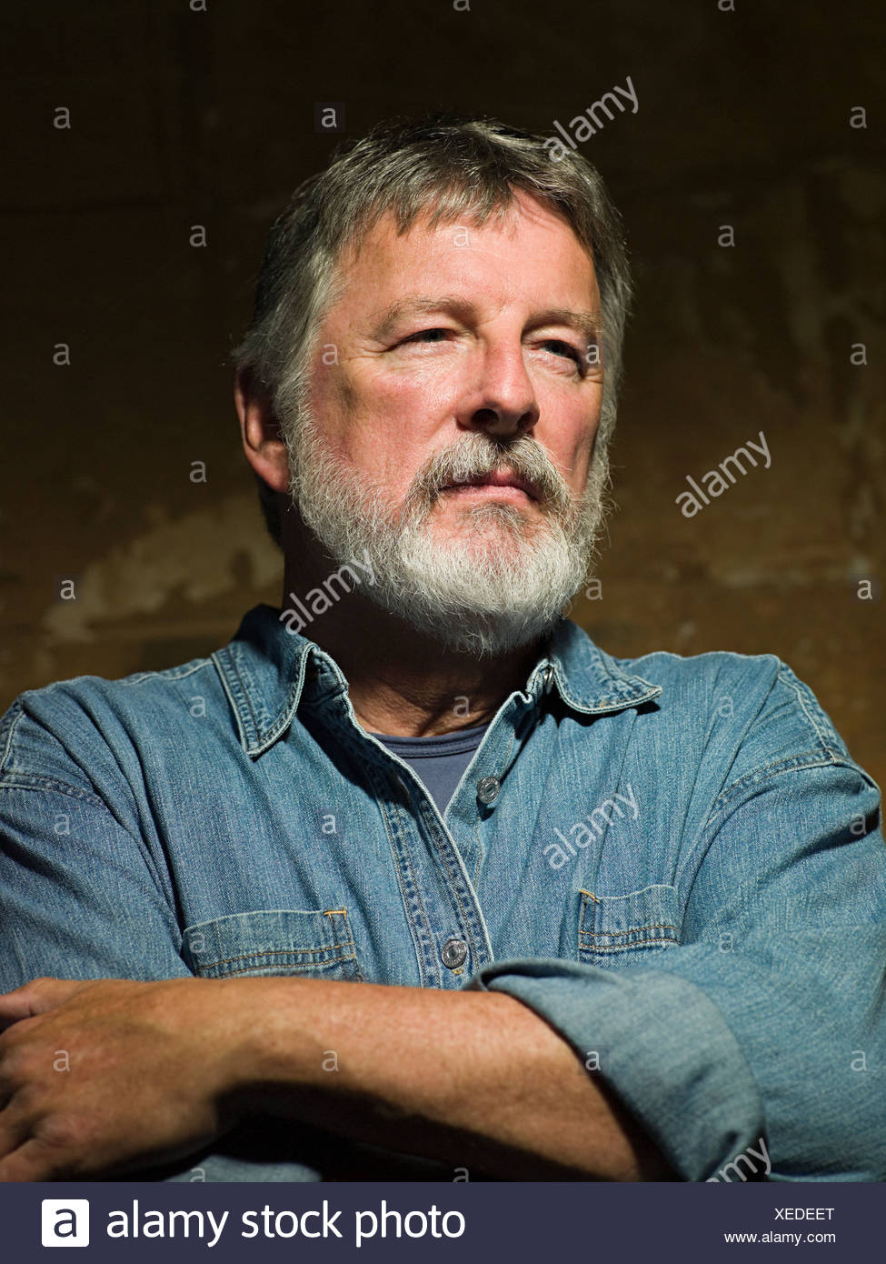Man wearing a denim shirt - Stock Image