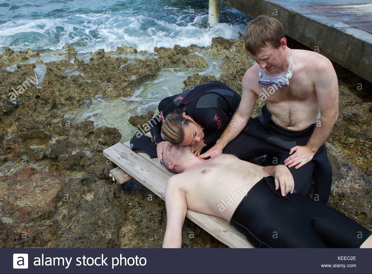Assessment of scuba diving accident victim - Stock Image