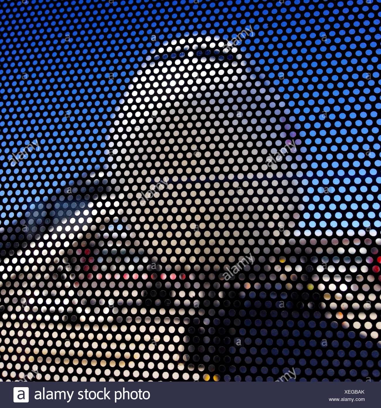 Plane viewed through metal mesh wall - Stock Image