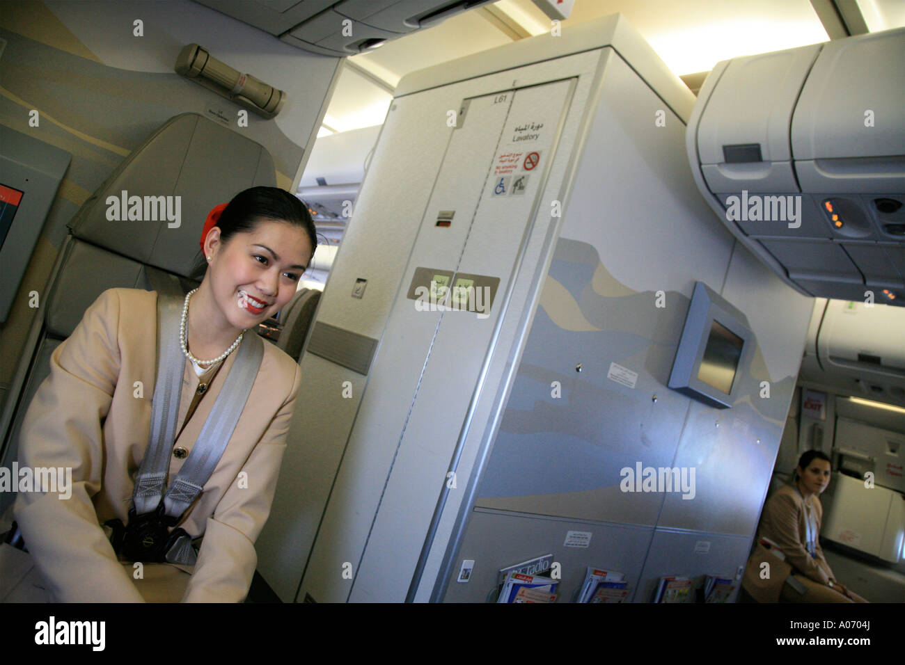 Emirates stewardess cabin crew lady smiling at camera - Emirates camera ...