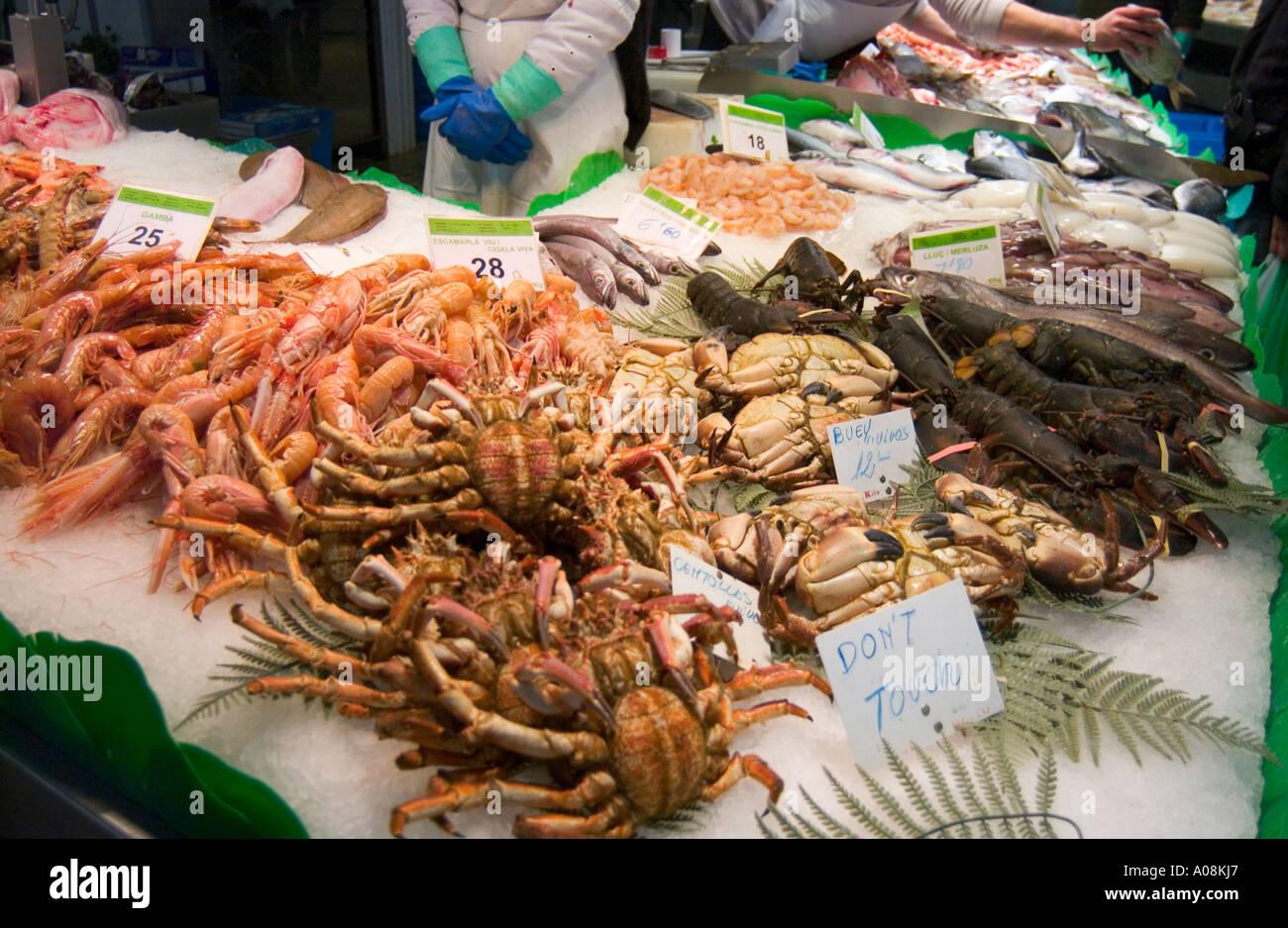 Fish stall selling fresh fish and seafood in la boqueria for La fish market