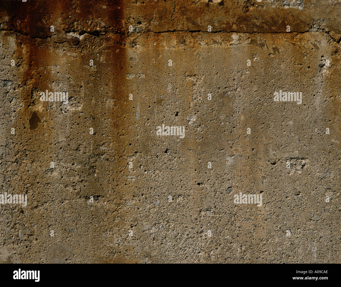 Rust Cement Wall : A close up of an aged and weathered cement or concrete