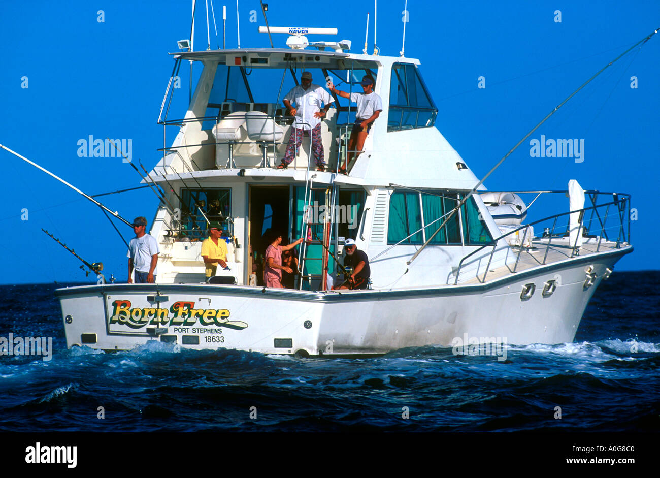 Big game fishing boat trolling near great barrier reef off for Boat fishing games