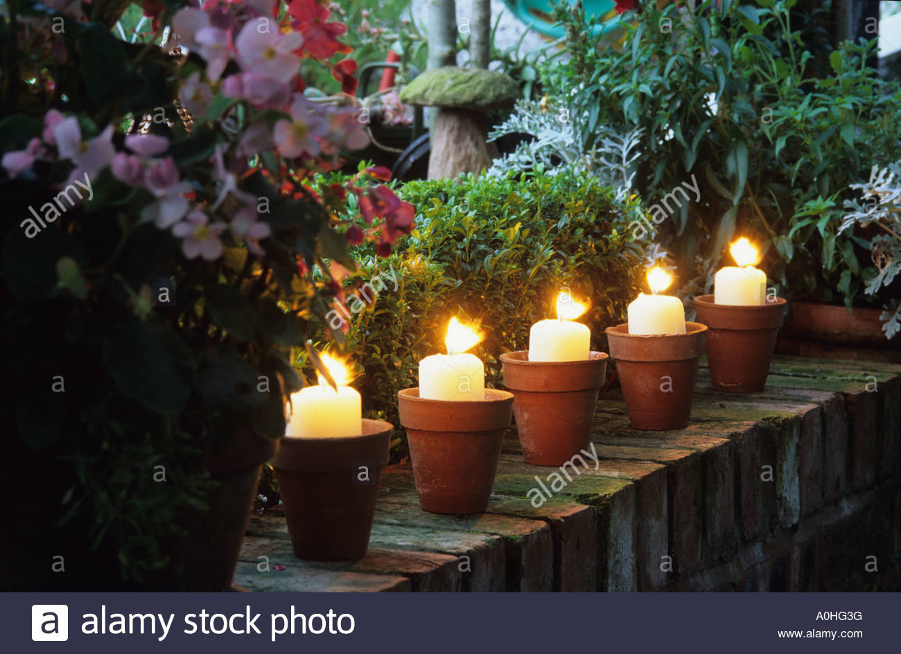 woodside rd  chester  garden lighting  candles in pots on