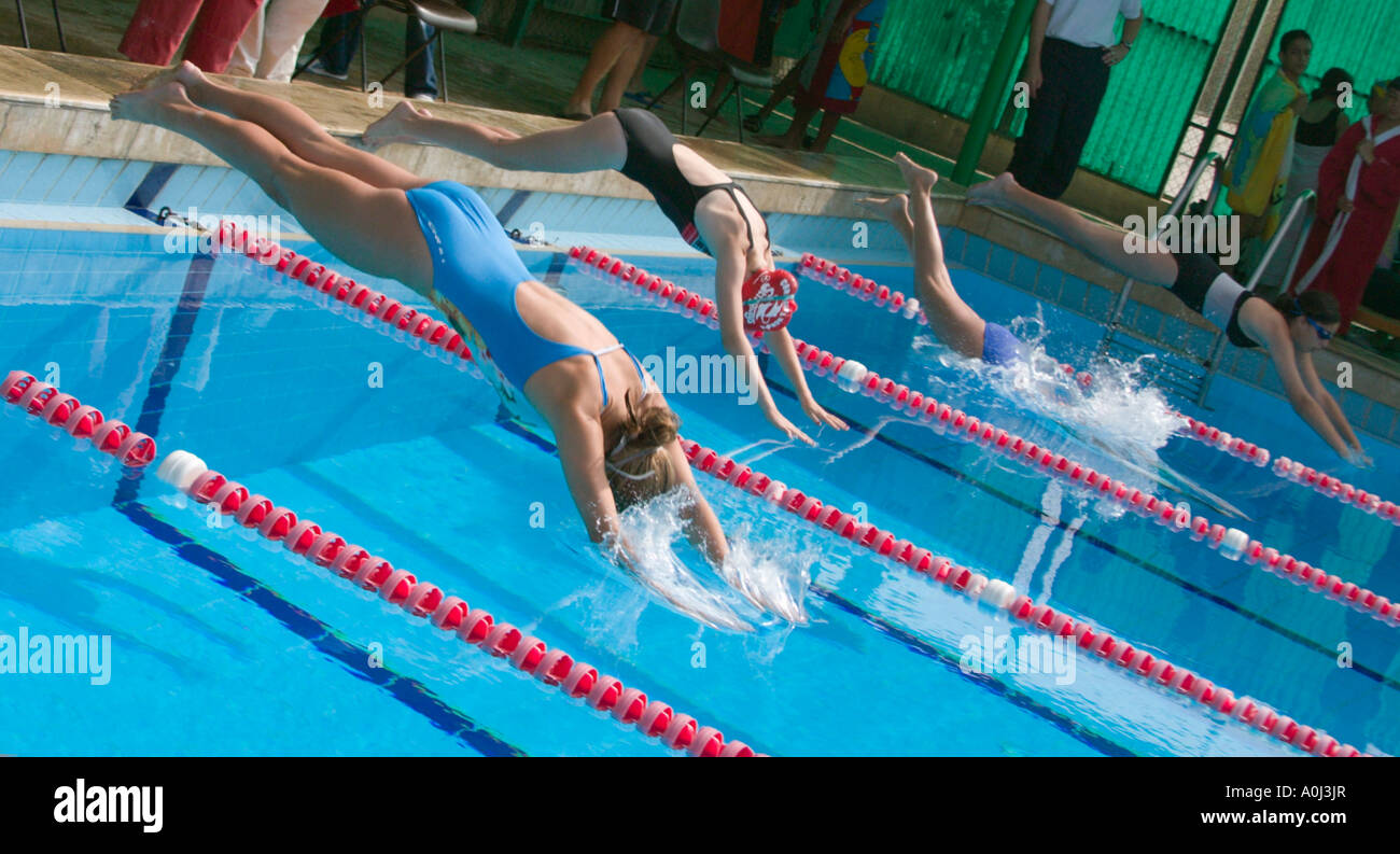 School Girls Diving Into Swimming Pool Stock Photo
