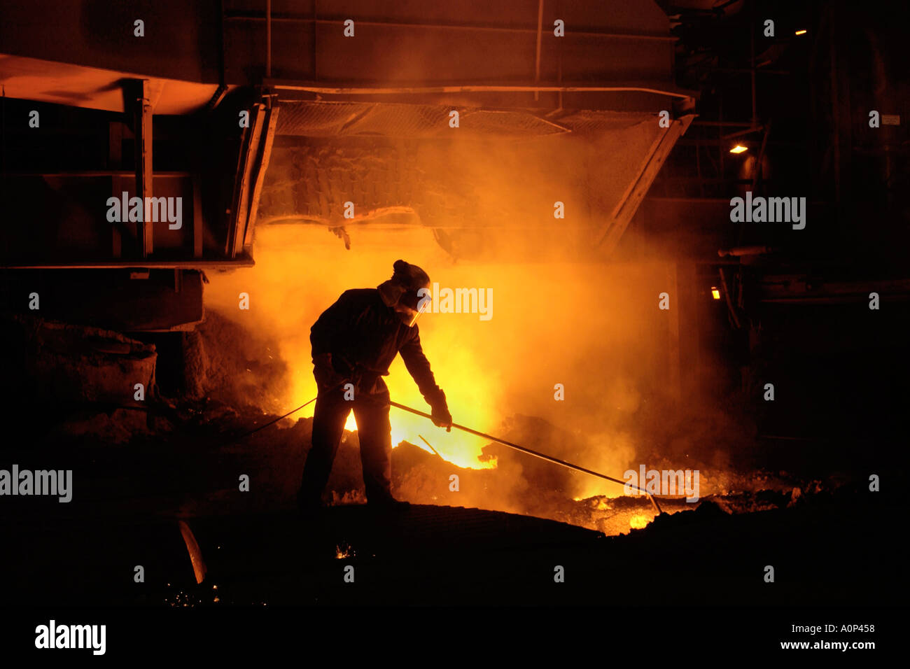 Team member taking iron samples using a lance on Blast Furnace No 5 at Tata Corus Steelworks Port Talbot South Wales Stock Photo