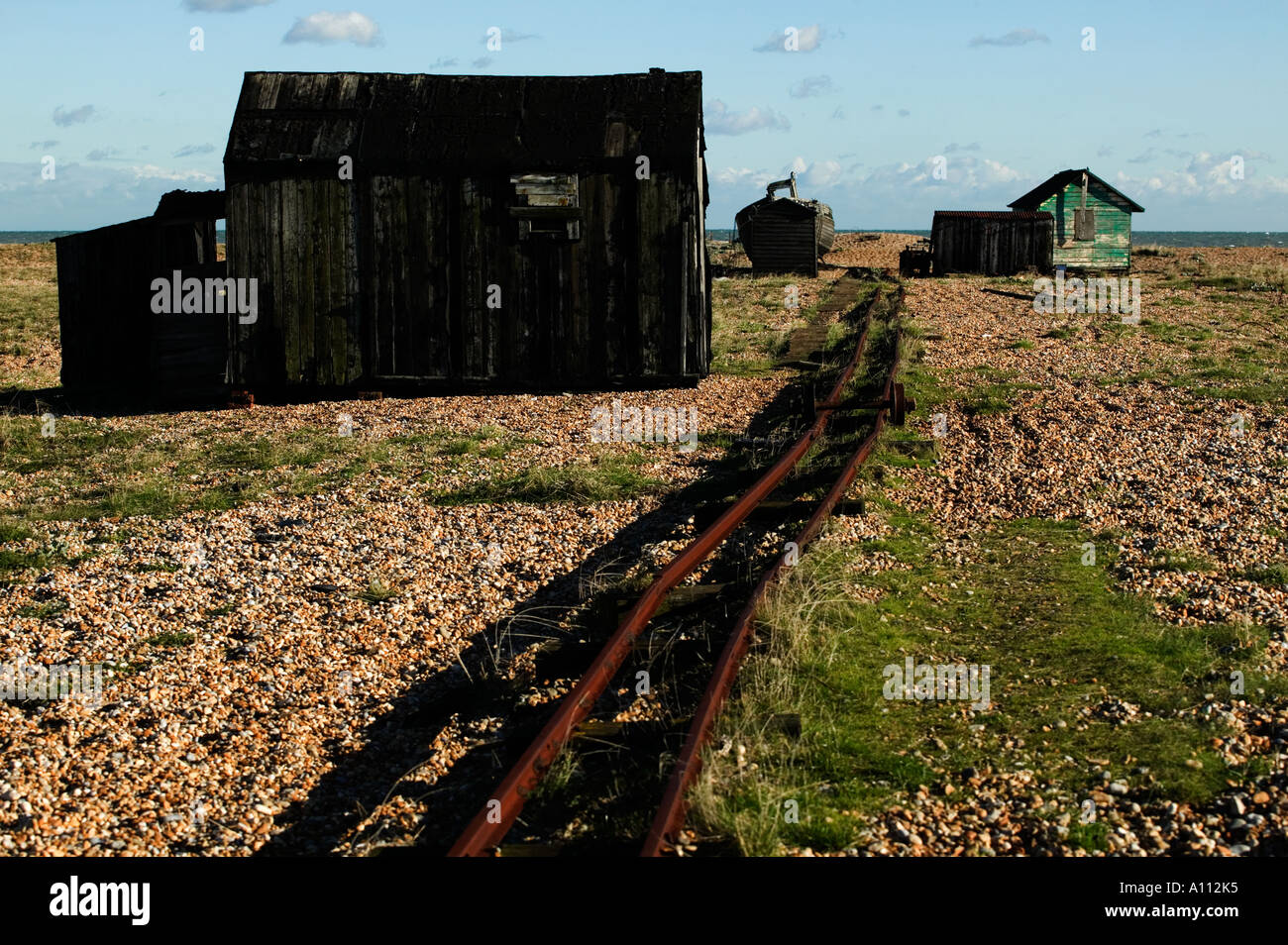 disused-rail-track-leading-to-dilapidate