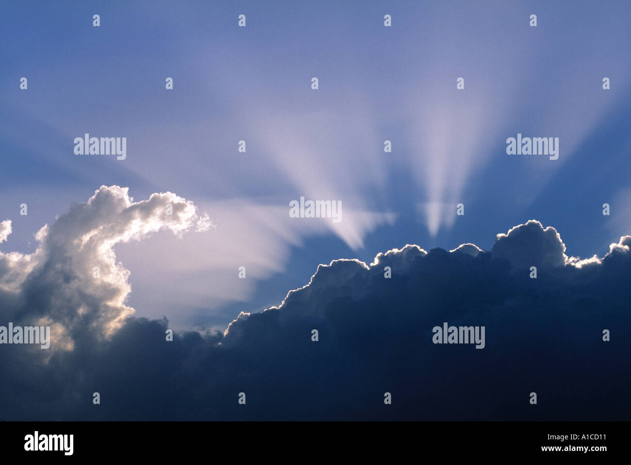 Sun rays through clouds Stock Photo