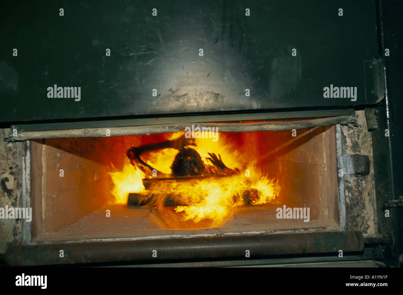 The body of an HIV/AIDS patient is cremated at Wat Prabat ...