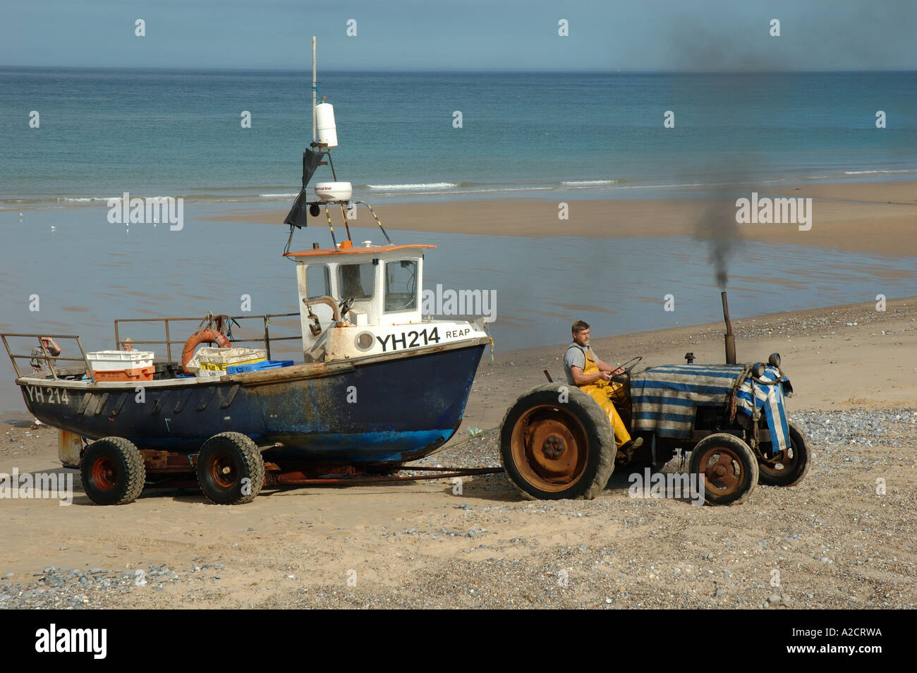 Tractor Pull Boats : Uk norfolk cromer tractor towing boat onto beach stock