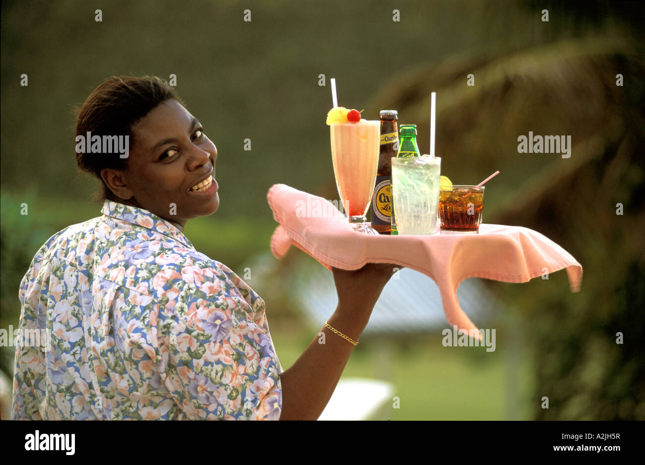 a-waitress-holds-a-tray-of-drinks-at-the