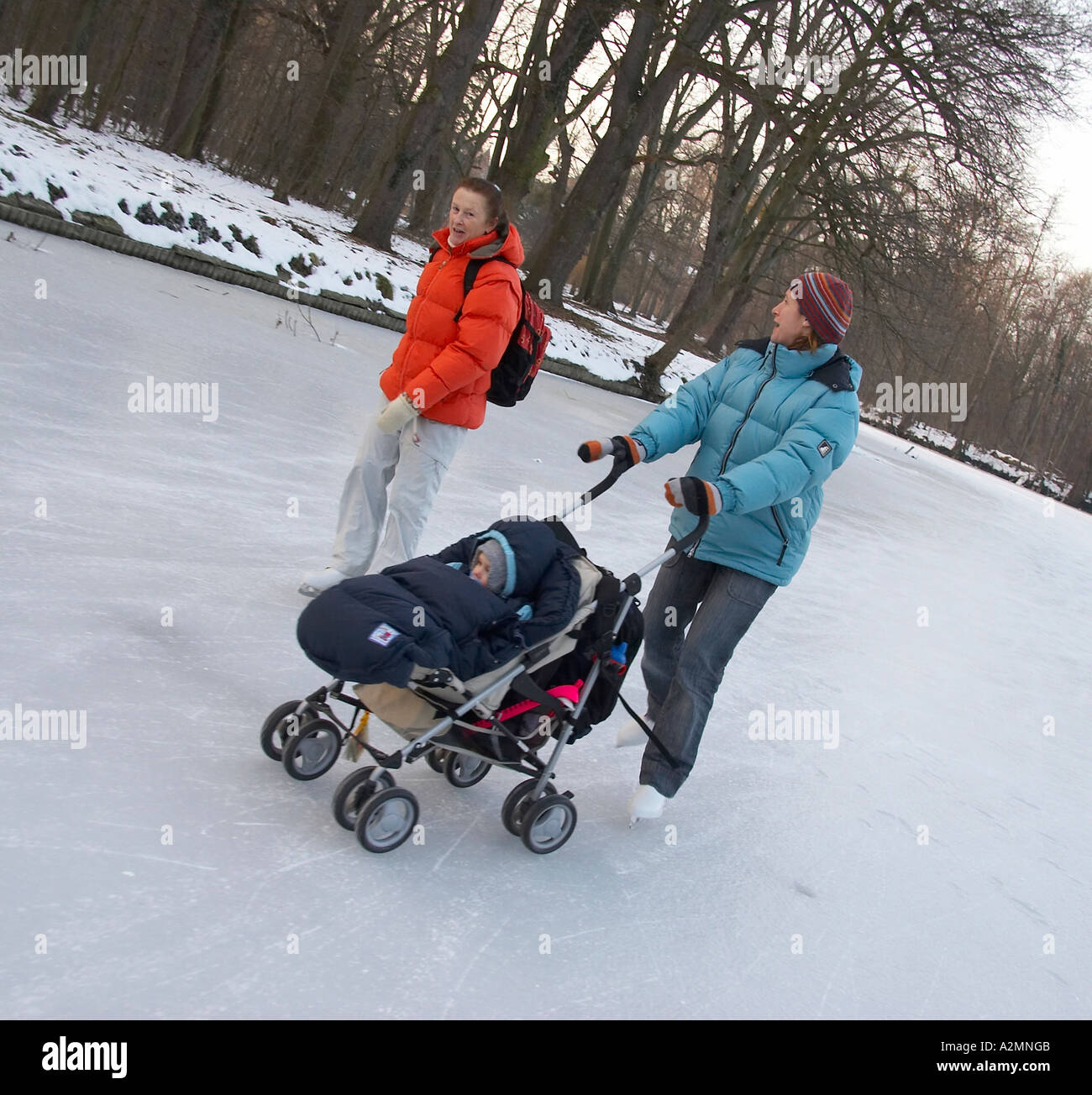 woman ice-skating with baby in stroller