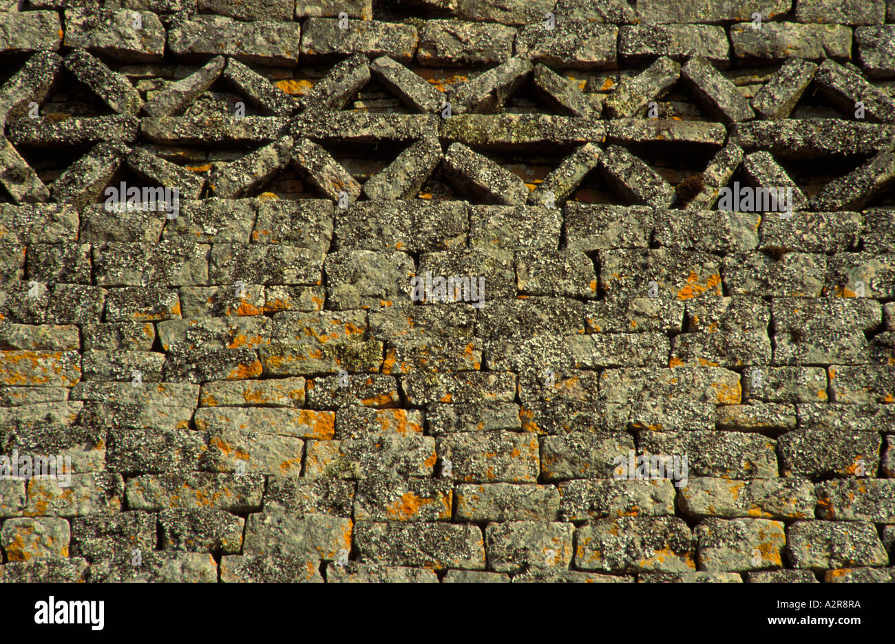 Detail showing herringbone or chevron pattern at top of for Outer wall design architecture