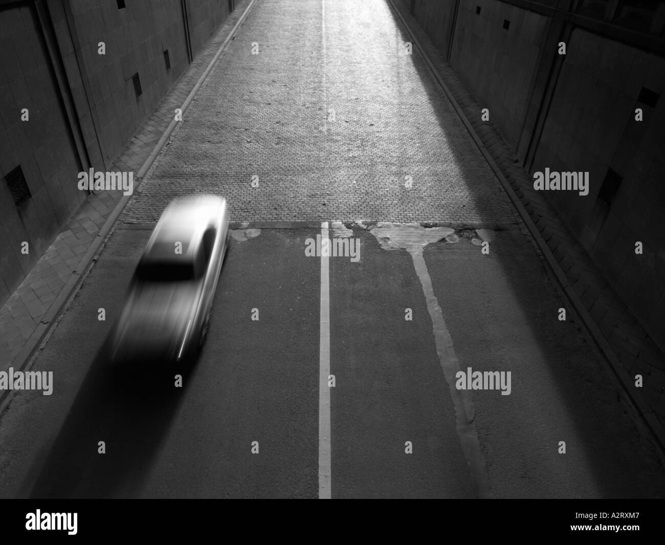 Silver car Mercedes speeding into tunnel Brussels Belgium motion blur monochrome black and white Stock Foto