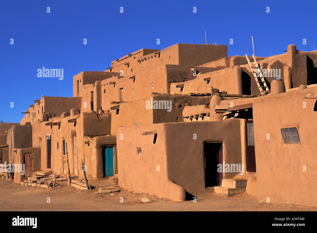 Taos pueblo native american community adobe homes taos new mexico usa stock photo royalty free - Pueblo adobe houses property ...